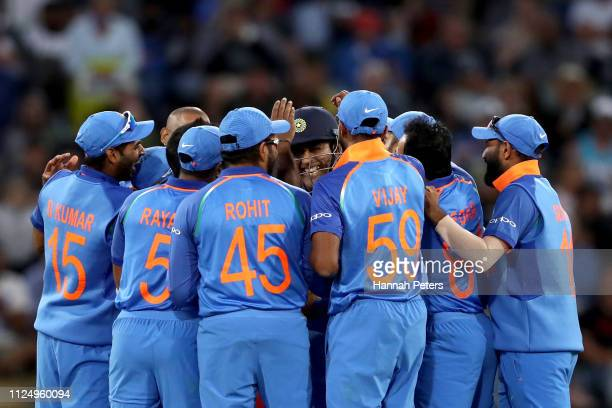 India celebrate the wicket of Ross Taylor of the Black Caps during game two of the One Day International Series between New Zealand and India at Bay...