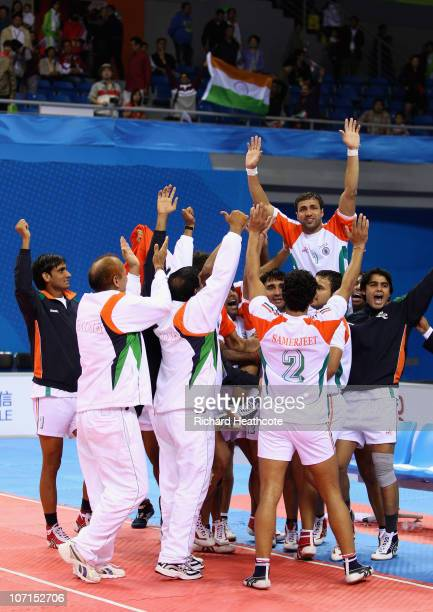 India celebrate victory over Iran during the Men's Kabaddi final at Nansha Gymnasium during day fourteen of the 16th Asian Games Guangzhou 2010 on...