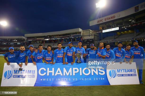 India celebrate winning the MyTeam11 ODI series between the West Indies and India at the Queen's Park Oval on August 14, 2019 in Port of Spain,...
