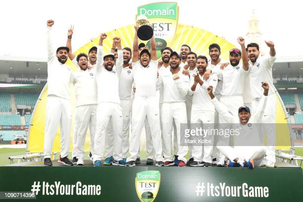 India celebrate with the trophy after a 2-1 series win after day five of the Fourth Test match in the series between Australia and India at Sydney...