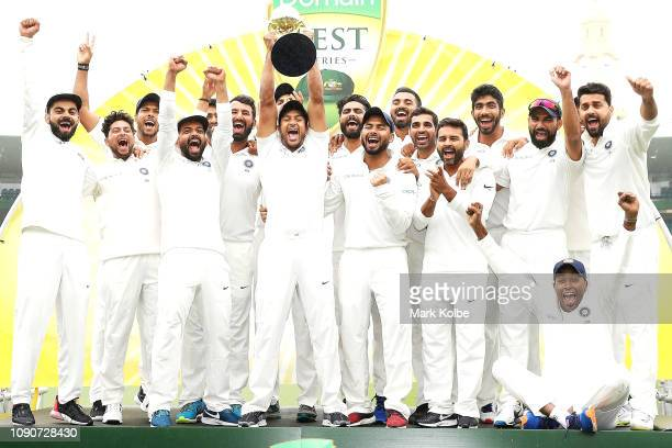 India celebrate with the trophy after a 21 series win after day five of the Fourth Test match in the series between Australia and India at Sydney...