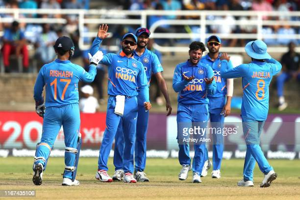 India celebrates a wicket during the second MyTeam11 ODI between the West Indies and India at the Queen's Park Oval on August 11 2019 in Port of...