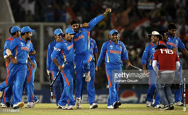 India celebrates after the defeat of Pakistan during the 2011 ICC World Cup second Semi-Final between Pakistan and India at Punjab Cricket...