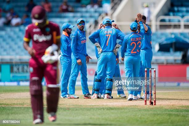 India celebrates after West Indies' Evin Lewis was caught out during the fifth One Day International match between West Indies and India at the...