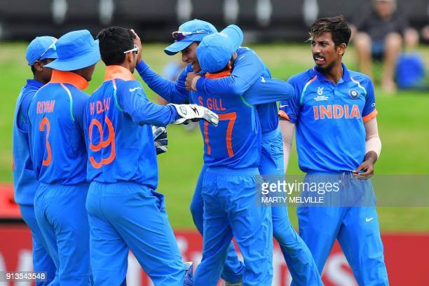 India celebrates Australia's Max Bryant being caught during the U19 World Cup cricket final match between India and Australia at Bay Oval in Mount...