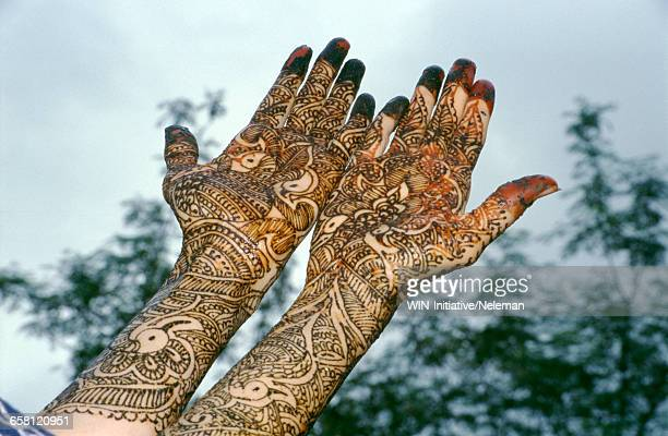 India, Close up of henna on a brides hands