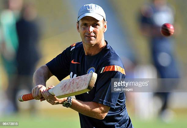 India coach Gary Kirsten of India gives slip practice before day two of the First Test match between India and South Africa at the Vidarbha Cricket...