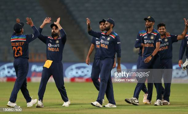 India congratulate Kuldeep Yadav after he catches out Jonathan Bairstow of England during 1st One Day International between India and England at MCA...