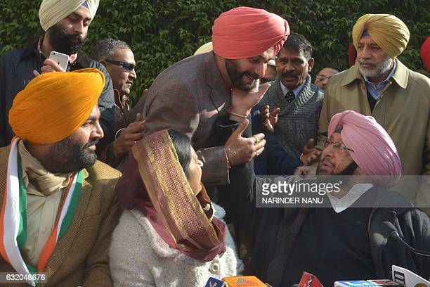 India Congress Punjab President and former chief minister of Punjab Amarinder Singh and cricketerturnedpolitician former member of parliament and...