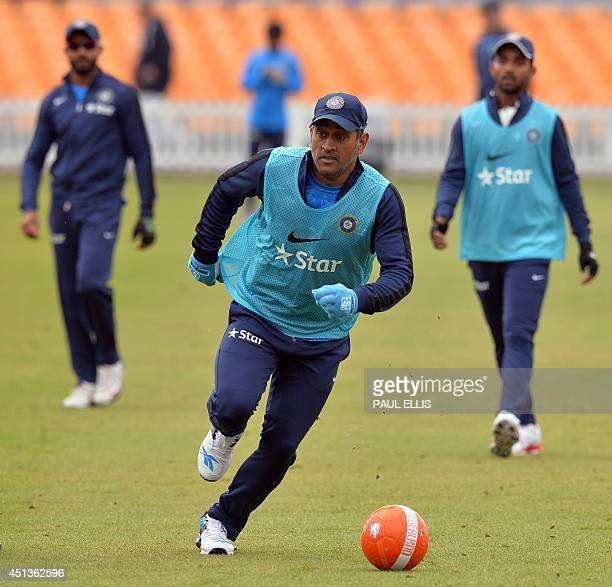 India cricket captain MS Dhoni plays football during a warm up seesion before play on the third day of the cricket Tour Match between Leicestershire...
