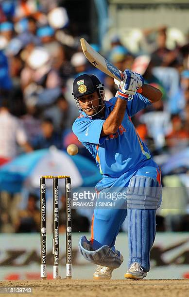 India cricket captain Mahendra Singh Dhoni plays a shot during the Cricket World Cup match between India and West Indies at the M A Chidambaram...