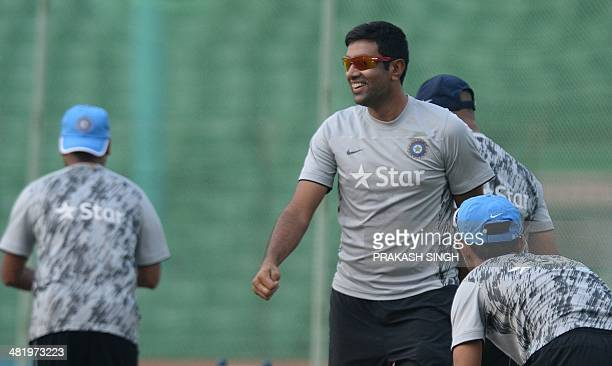 India cricketer Ravichandran Ashwin smiles as he bowls in nets at a training session during the ICC World Twenty20 tournament in The Khan Saheb Osman...