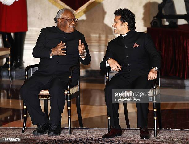 India cricketer Sachin Tendulkar and scientist Chintamani Nagesa Ramachandra Rao chat during an awards ceremony at the Presidential Palace on...