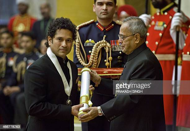 India cricketer Sachin Tendulkar receives 'Bharat Ratna' award from Indian President Pranab Mukherjee during an awards ceremony at the Presidential...
