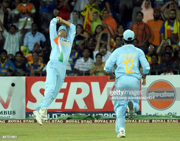 India cricketer Suresh Raina takes a catch to dismiss Sri Lankan cricketer Tilakratne Dilshan durng the Twenty20 International match between India...