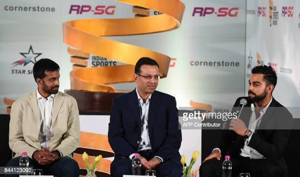 India Cricketer Virat Kohli addresses the media as Chairman RPSG group Sanjiv Goenka and Chief National Coach for the Indian Badminton team Pullela...