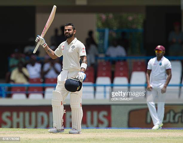India cricketer Virat Kohli celebrates after batting 200 runs during day two of the cricket test match between West Indies and India July 22 2016 at...