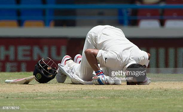 India cricketer Virat Kohli kisses the ground after batting 200 runs during day two of the cricket test match between West Indies and India July 22...