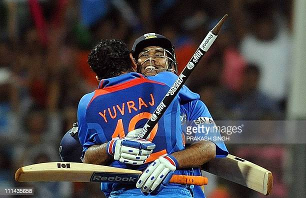 India cricketer Yuvraj Singh and captain Mahendra Singh Dhoni celebrate their victory in the ICC Cricket world Cup final match between India and Sri...