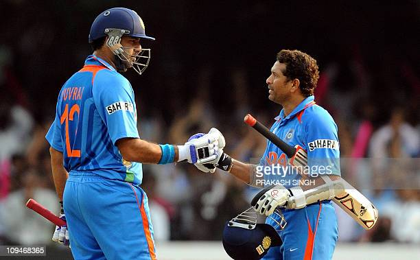 India cricketer Yuvraj Singh congratulates teammate Sachin Tendulkar after his century during the Cricket World Cup match between England and India...