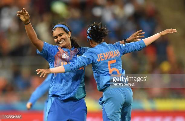 India cricketers Shikha Pandey and Jemimah Rodrigues celebrate beating Australia in the opening match of the women's Twenty20 World Cup cricket...
