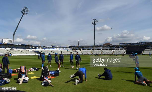 India cricketers take part in a training session at Edgbaston cricket ground in Birmingham on June 14 ahead of the ICC Champions Trophy semifinal...