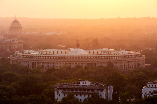 India, Delhi, New Delhi, Parliament Building at sunset, pollution, smog - gettyimageskorea