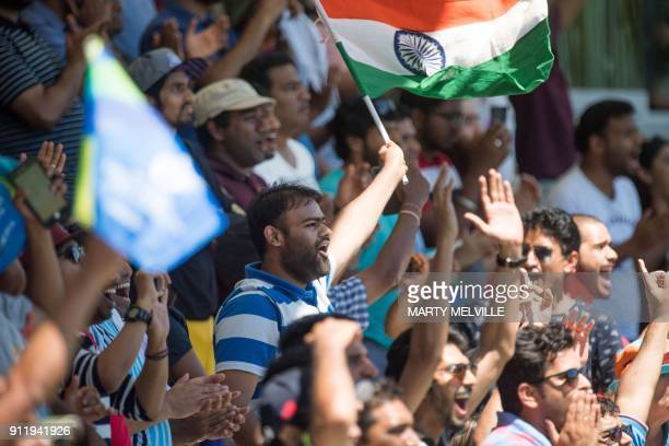 India fans celebrate India's Shubman Gill's 100 runs during the U19 semifinal cricket World Cup match between India and Pakistan at Hagley Oval in...
