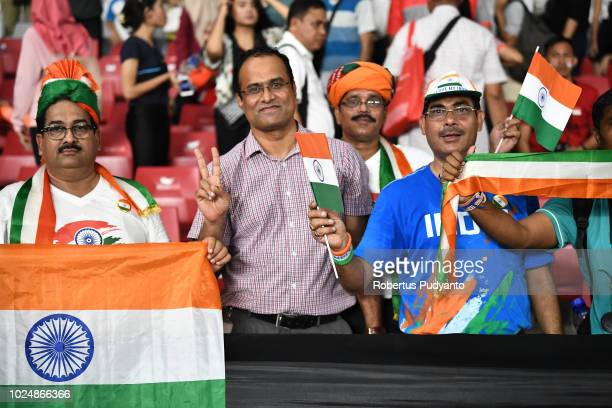 India fans cheer during the Mixed 4x400m Relay Final on day ten of the Asian Games on August 28 2018 in Jakarta Indonesia