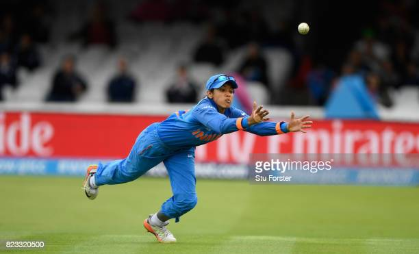 India fielder Smitri Mandhana dives in vain to take a catch during the ICC Women's World Cup 2017 Final between England and India at Lord's Cricket...