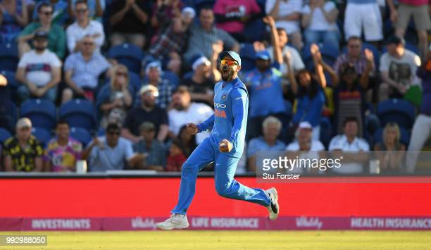 India fielder Virat Kohli celebrates after catching out Jos Buttler during the 2nd Vitality T20 International between England and India at Sophia...