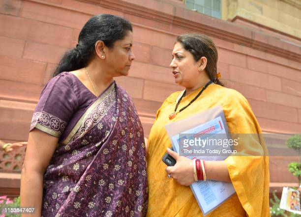 India Finance Minister Nirmala Sitharaman walks to the Parliament with Smriti Irani after the BJP parliamentary committee meeting in New Delhi