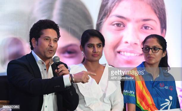 India former cricketer and UNICEF Goodwill Ambassador Sachin Tendulkar speaks as Indian women's cricket team captain Mithali Raj and Special Olympics...