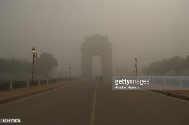 India Gate a war memorial and one of the iconic monument of Delhi is seen covered with toxic smog in Delhi India on November 08 2017