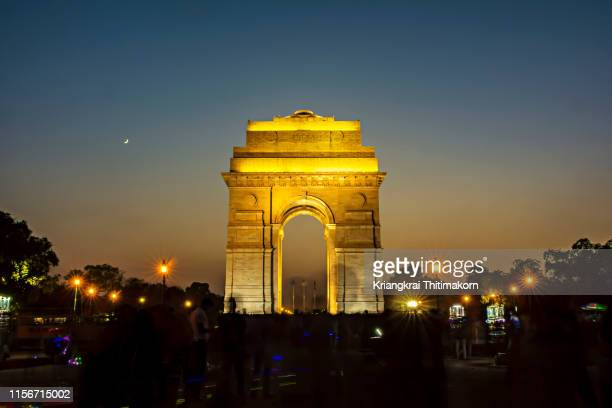 india gate at night, new delhi. - history stock pictures, royalty-free photos & images
