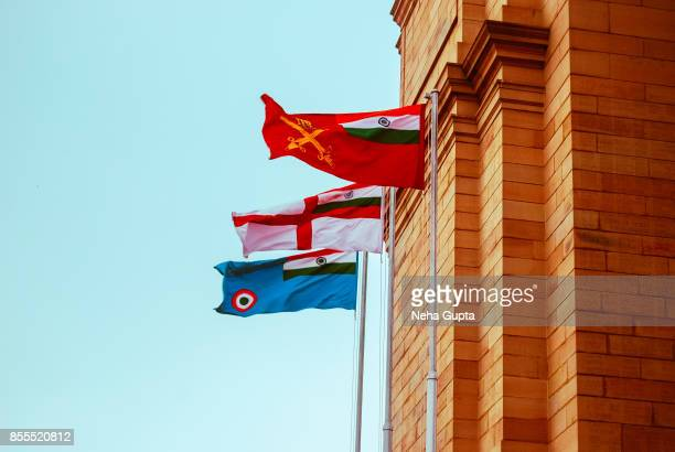 india gate - flags of the three armed forces of india - indian military stock photos and pictures