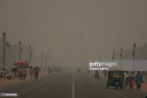 India Gate one of the national monuments in Delhi seen engulfed in the toxic smog with zero visibility which forces government to declare public...