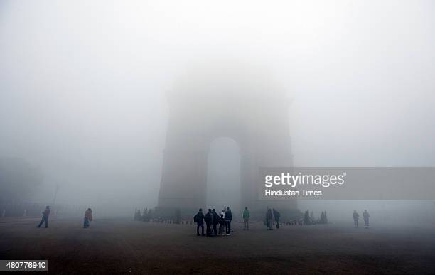 India Gate surrounded by dense fog on a cold and foggy morning on December 22 2014 in New Delhi India Dense fog reduced visibility to 50 metres Due...