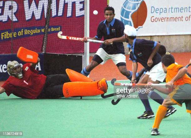 India goalkeeper Devesh Chauhan tries desperately to stop the equalising goal shot by Jamie Dwyer of Australia during the game that Australia won by...