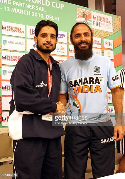 India hockey team captain Rajpal Singh and Pakistan hockey team captain Zeeshan Ashraf pose during a press conference in New Delhi on February 26 2010