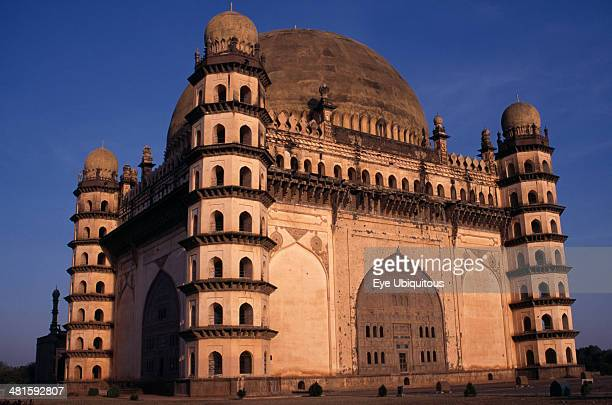 India Karnataka Bijapur The Golgumbaz Exterior of domed building with octagonal sevenstory towers at each corner Built in 1659 as the mausoleum of...