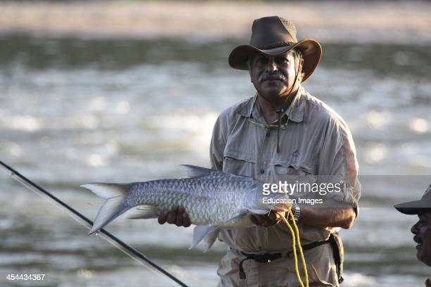 India Karnataka State Galibore Fishing And Nature Camp On The Banks Of The Cauvery River Fishing For Mahseer On A Catch And Release Basis Man With A...