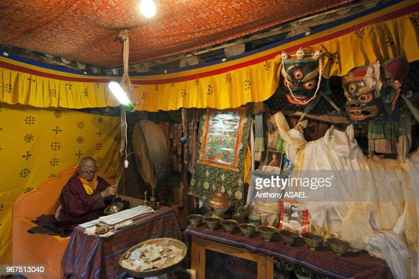 India Ladakh Hemis monk praying inside Hemis Monastery constructed out of wood