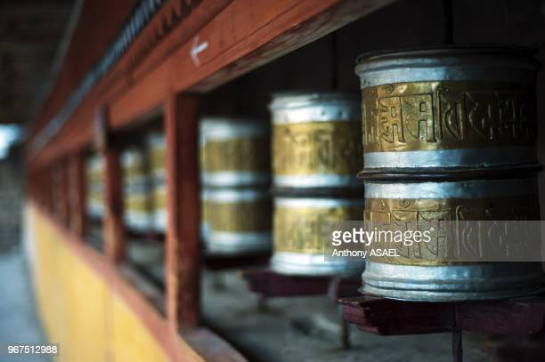 India Ladakh Hemis prayer wheels in Hemis Monastery constructed out of wood