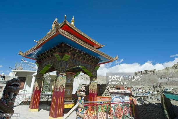 India Ladakh Leh small colorful buddhist temple with dragon figure and Leh Palace in background