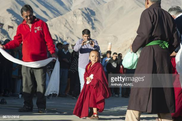 India Ladakh Leh small monk honored at Shanti Stupa during tibetan ceremony