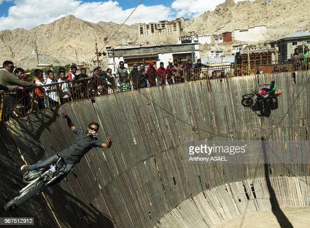 India Ladakh Leh tibetan circus fair with stunt man going vertical with car and motorcycle