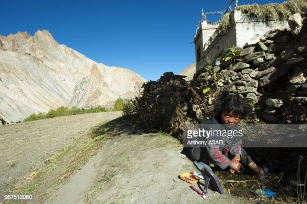 India Ladakh Markha Valley small girl washing hands in small stream