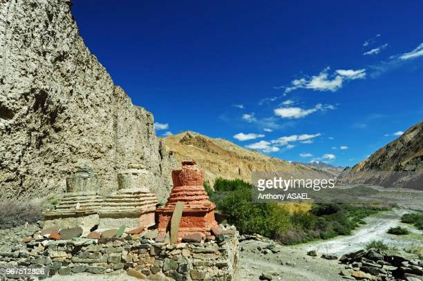 India Ladakh Markha Valley white and colored stupa in scenic landscape of the Himalayas with Markha stream river