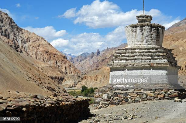 India Ladakh Markha Valley white stupa in scenic landscape of the Himalayas with Markha stream river